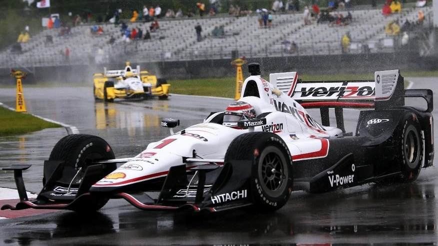 Will Power, of Australia, turns into pit lane during the qualification session for the IndyCar Grand Prix of Louisiana auto race, Saturday, April 11, 2015, in Avondale, La. Qualifications were canceled due to rain. (AP Photo/Jonathan Bachman)
