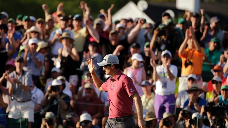 Justin Rose, of England, waves to the gallery after a birdie on the 18th fairway during the third round of the Masters golf tournament Saturday, April 11, 2015, in Augusta, Ga. (AP Photo/Matt Slocum)