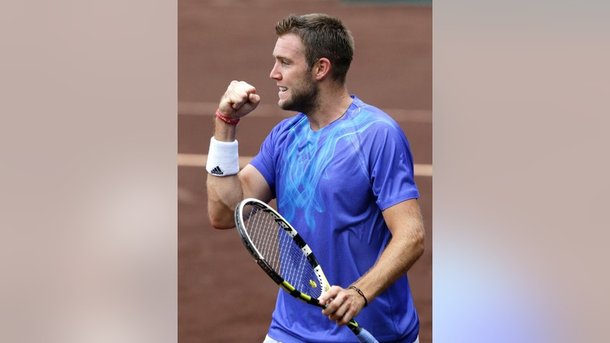 Jack Sock of the United States raises his fist on his way to defeating Kevin Anderson 7-6 (3), 6-3 in a semifinal match at the U.S. Men's Clay Court Championship Saturday, April 11, 2015, in Houston. (AP Photo/Pat Sullivan)