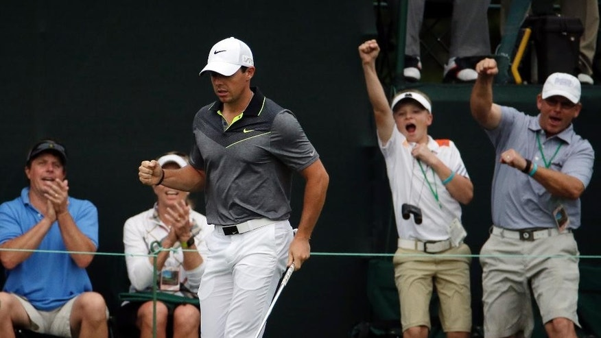 Rory McIlroy, of Northern Ireland, reacts after a birdie on the 17th hole during the second round of the Masters golf tournament Friday, April 10, 2015, in Augusta, Ga. (AP Photo/Charlie Riedel)