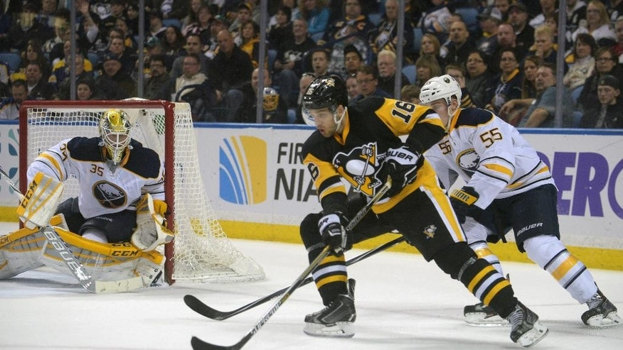 Buffalo Sabres goaltender Anders Lindback (35), of Sweden, and defenseman Rasmus Ristolainen (55), of Finland, defend as Pittsburgh Penguins center Brandon Sutter (16) skates in front of the net during the second period of an NHL hockey game Saturday, April 11, 2015, in Buffalo, N.Y. (AP Photo/Gary Wiepert)