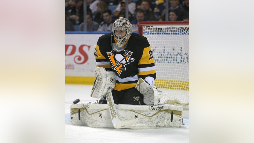 Pittsburgh Penguins goaltender Marc-Andre Fleury makes a save during the first period of an NHL hockey game against the Buffalo Sabres, Saturday, April 11, 2015, in Buffalo, N.Y. (AP Photo/Gary Wiepert)