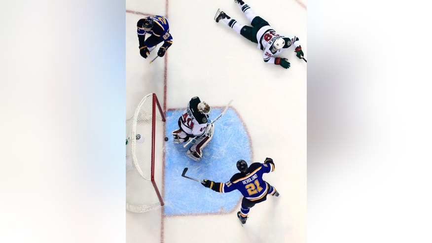 St. Louis Blues' Dmitrij Jaskin (23), of Russia, scores past Minnesota Wild goalie Devan Dubnyk (40) as Wild's Nate Prosser  and Blues' Patrik Berglund (21), of Sweden, watch during the second period of an NHL hockey game Saturday, April 11, 2015, in St. Louis. (AP Photo/Jeff Roberson)