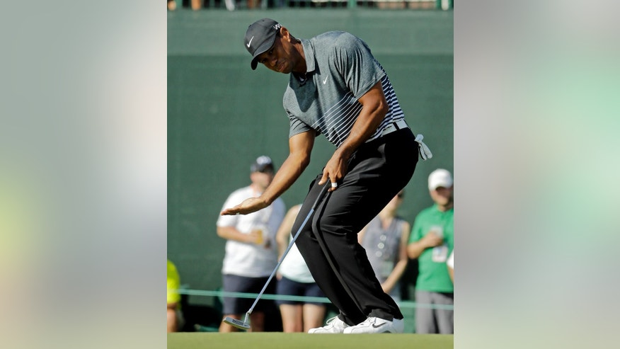 Tiger Woods coaxes his ball on the 17th green during the third round of the Masters golf tournament Saturday, April 11, 2015, in Augusta, Ga. (AP Photo/Darron Cummings)