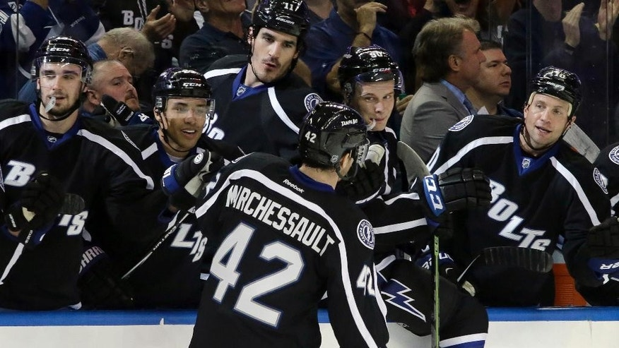 Tampa Bay Lightning center Jonathan Marchessault (42) celebrates his goal against the Boston Bruins with the bench during the second period of an NHL hockey game Saturday, April 11, 2015, in Tampa, Fla. (AP Photo/Chris O'Meara)