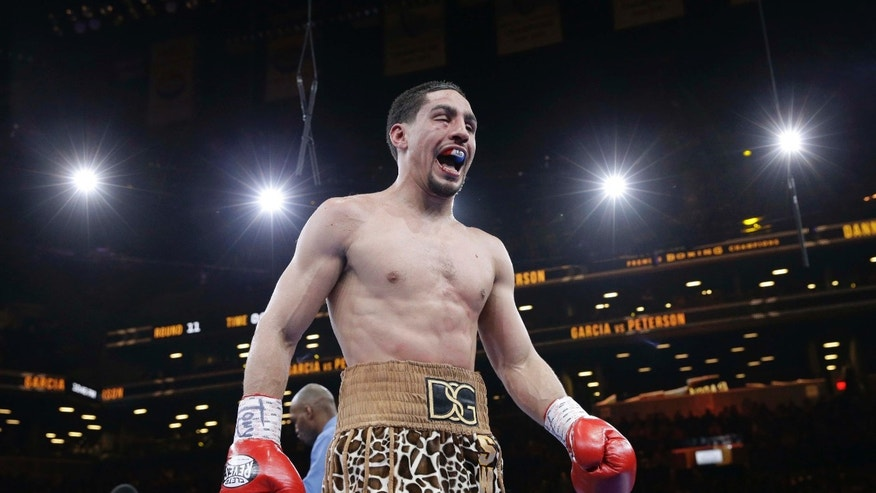 Danny Garcia reacts while returning to his corner after the 11th round during a super lightweight boxing match against Lamont Peterson, Saturday, April 11, 2015, in New York. Garcia won by a majority decision. (AP Photo/Mary Altaffer)