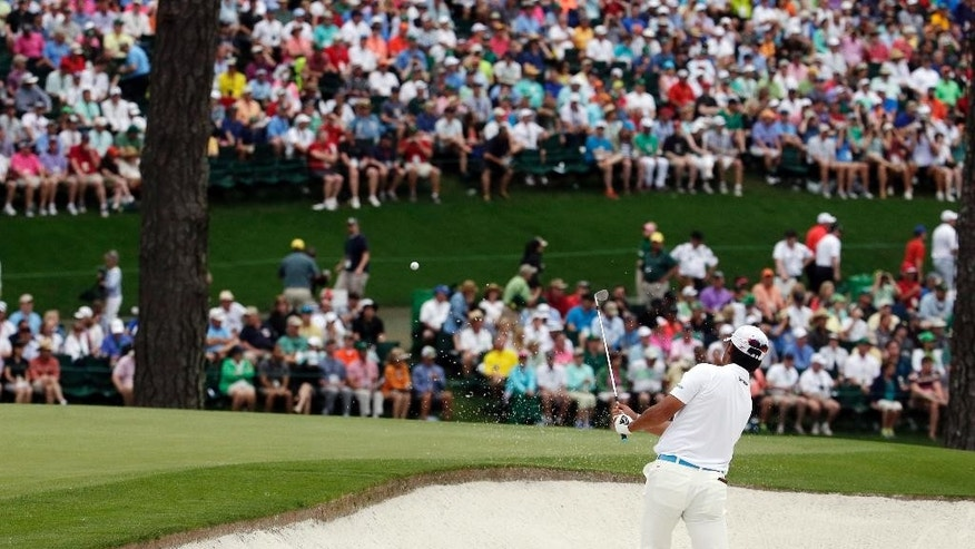 Hideki Matsuyama, of Japan, hits out of a bunker on the 15th hole during the fourth round of the Masters golf tournament Sunday, April 12, 2015, in Augusta, Ga. (AP Photo/Charlie Riedel)
