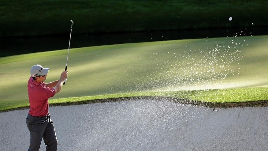 Russell Henley hits out of the rough on the first fairway during the fourth round of the Masters golf tournament Sunday, April 12, 2015, in Augusta, Ga. (AP Photo/David J. Phillip)