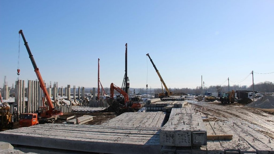 In this photo taken Friday, March 6, 2015 and provided by Profit Organisation Directorate on preparation and staging of the 2018 World Cup in the Host City of Saransk, a stadium for the 2018 World Cup is under construction in Saransk, Russia. With a population of around 300,000, Saransk is the smallest of the 11 Russian cities which will host World Cup matches in 2018. (AP Photo/Profit Organisation Directorate)