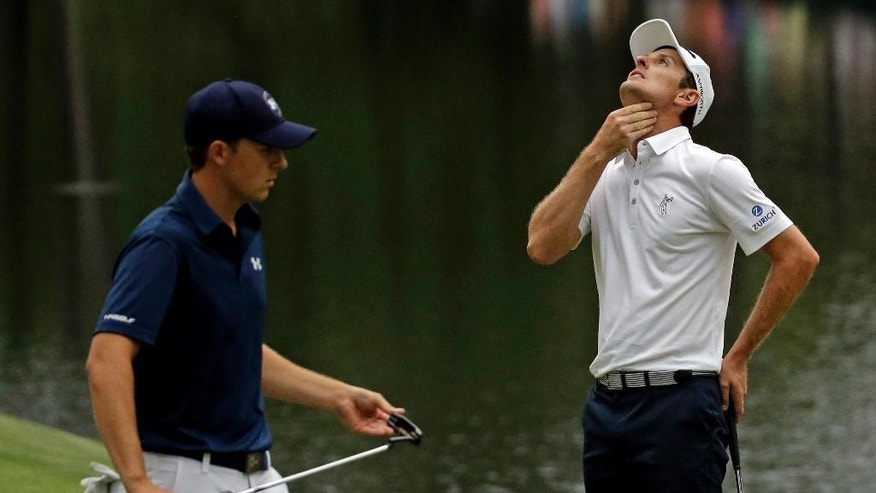 Justin Rose, of England, reacts after missing a putt on the 16th hole during the fourth round of the Masters golf tournament Sunday, April 12, 2015, in Augusta, Ga. Left is Jordan Spieth. (AP Photo/Matt Slocum)