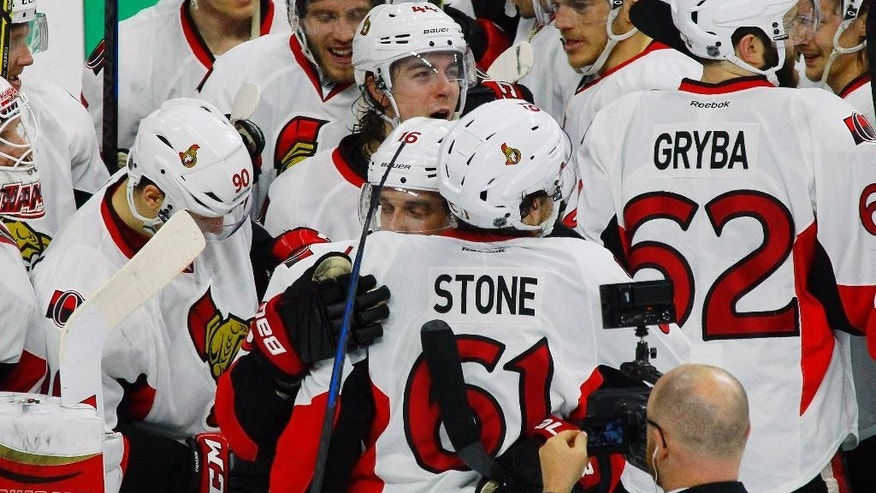 The Ottawa Senators celebrate after they defeated the Philadelphia Flyers in an NHL hockey game, Saturday, April 11, 2015, in Philadelphia. The Senators won 3-1.(AP Photo/Tom Mihalek)