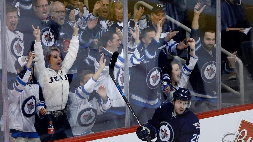 Winnipeg Jets' Lee Stempniak (20) and fans celebrate his goal against the Calgary Flames during the third period of an NHL hockey game, Saturday, April 11, 2015 in Winnipeg, Manitoba.  (John Woods/The Canadian Press via AP)   MANDATORY CREDIT
