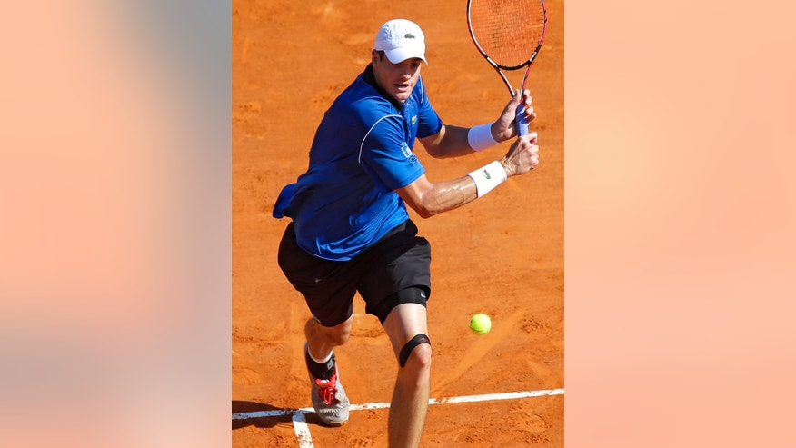 US player John Isner plays a return to US player Steve Johnson during their match of the Monte Carlo Tennis Masters tournament in Monaco, Monday, April 13, 2015. (AP Photo/Lionel Cironneau)