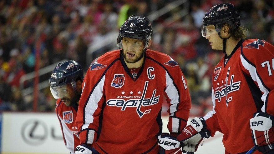 FILE - In this April 8, 2015, file photo, Washington Capitals left wing Alex Ovechkin (8), of Russia, talks with  John Carlson (74) during the second period of an NHL hockey game against the Boston Bruins in Washington. For all of his goals and trio of MVP trophies, Ovechkin never has been past the second round of the NHL playoffs. (AP Photo/Nick Wass, File)