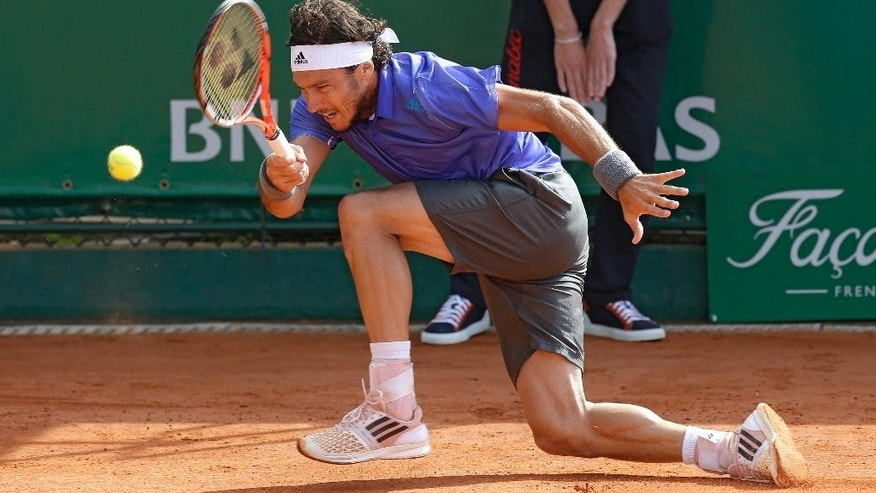 Juan Monaco of Argentina plays a return to Jiry Vesely of Czech Republic during their match of the Monte Carlo Tennis Masters tournament in Monaco, Tuesday, April 14, 2015. (AP Photo/Lionel Cironneau)
