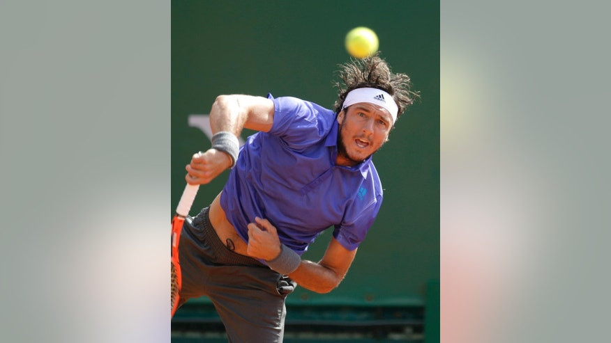Juan Monaco of Argentina serves the ball to Jiry Vesely of Czech Republic during their match of the Monte Carlo Tennis Masters tournament in Monaco, Tuesday, April 14, 2015. (AP Photo/Lionel Cironneau)