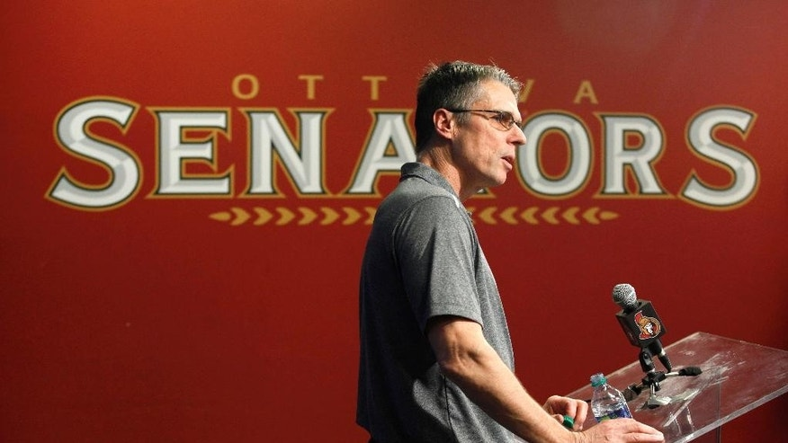Ottawa Senators coach Dave Cameron speaks at a press conference at the Canadian Tire Centre in Ottawa, after the announcement of the death of assistant coach Mark Reeds, Tuesday, April 14, 2015.  (Patrick Doyle/The Canadian Press via AP)   MANDATORY CREDIT