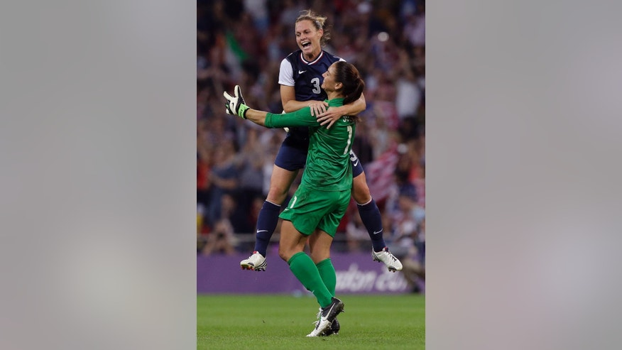 FILE - In this Aug. 9, 2012, file photo, United States' Christie Rampone (3) celebrates with teammate Hope Solo (1) after winning the women's soccer gold medal match against Japan at the 2012 Summer Olympics in London. The pair are on the U.S. Women's World Cup roster. Coach Jill Ellis on Tuesday, April 14, 2015, announced her 23 picks for the tournament in Canada. Seeking their third title and first since 1999, the Americans open against Australia on June 8. (AP Photo/Julie Jacobson, File)