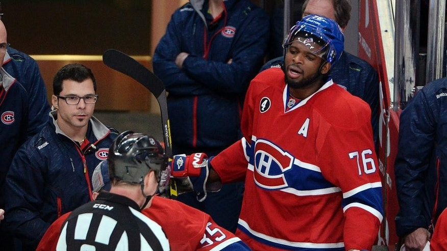 Montreal Canadiens defenseman P.K. Subban (76) argues with referee Dave Jackson after receiving a game misconduct during the second period of Game 1 in an NHL hockey first-round playoff series against the Ottawa Senators on Wednesday, April 15, 2015, in Montreal. (Ryan Remiorz/The Canadian Press via AP)
