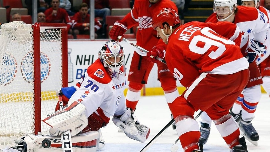 FILE - In this April 5, 2015, file photo, Washington Capitals goalie Braden Holtby (70) blocks a shot by Detroit Red Wings center Stephen Weiss (90) during the second period of an NHL hockey game in Detroit. Today's netminders are relying on size and agility to stop shots instead of just subscribing to a certain style of goaltending. These aren't your typical butterfly goaltenders anymore, a traditional style where netminders spread their goal pads and hands to resemble a butterfly's wings.  (AP Photo/Paul Sancya, File)
