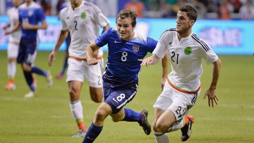 USA defender Jordan Morris (8) chases the ball against Mexico defender Hiram Mier during the first half of an international friendly soccer match, Wednesday, April 15, 2015, in San Antonio. (AP Photo/Darren Abate)