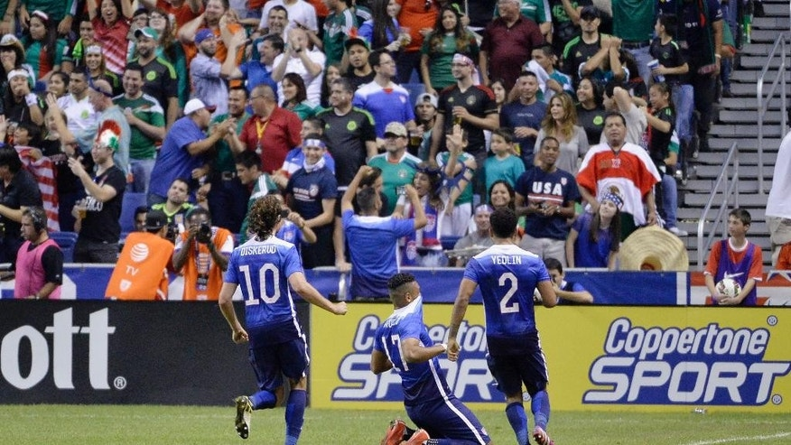 USA forward Juan Agudelo (17) celebrates a goal with teammates Mix Diskerud (10) and DeAndre Yedlin during the second half of an international friendly soccer match against Mexico, Wednesday, April 15, 2015, in San Antonio. United States won 2-0. (AP Photo/Darren Abate)