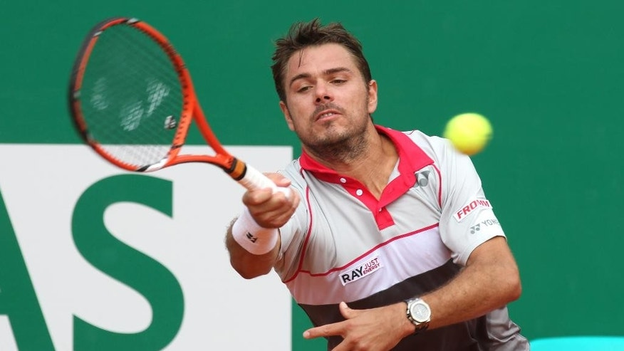 Stanislas Wawrinka of Switzerland plays a return to Juan Monaco of Argentina during their match of the Monte Carlo Tennis Masters tournament in Monaco, Wednesday, April 15, 2015. (AP Photo/Lionel Cironneau)