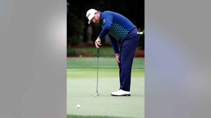 Graeme McDowell, of Northern Ireland, reacts to a missed birdie on the 16th green during the first round of the RBC Heritage golf tournament in Hilton Head Island, S.C., Thursday, April 16, 2015. (AP Photo/Stephen B. Morton)