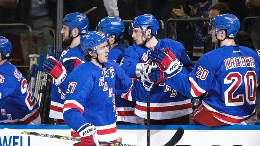 New York Rangers' Ryan McDonagh (27) celebrates with teammates after scoring a goal during the first period of Game 1 against the Pittsburgh Penguins in the first round of the NHL hockey Stanley Cup playoffs Thursday, April 16, 2015, in New York.  (AP Photo/Frank Franklin II)
