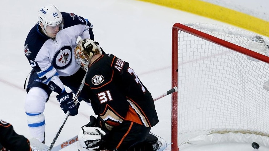 Winnipeg Jets center Mark Scheifele, left, watches as right wing Drew Stafford's goal goes by Anaheim Ducks goalie Frederik Andersen during the second period of Game 1 of a first-round NHL hockey playoff series in Anaheim, Calif., Thursday, April 16, 2015. (AP Photo/Chris Carlson)