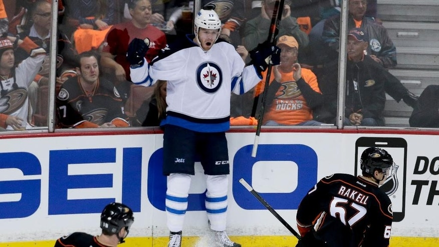 Winnipeg Jets left wing Adam Lowry, middle, celebrates his goal as Anaheim Ducks right wing Tim Jackman, left, and center Rickard Rakell skate by during the first period of Game 1 of a first-round NHL hockey playoff series in Anaheim, Calif., Thursday, April 16, 2015. (AP Photo/Chris Carlson)