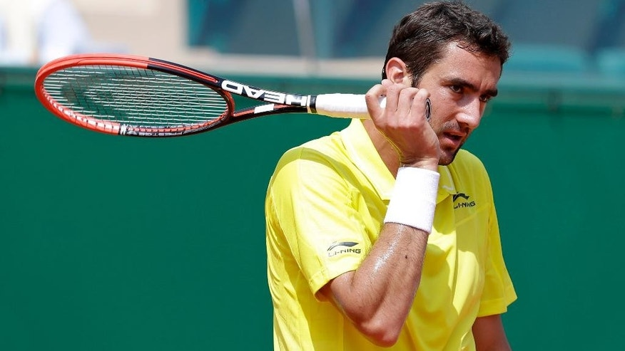 Marin Cilic of  Croatia during his quarterfinal match of the Monte Carlo Tennis Masters tournament against Novak Djokovic of Serbia in Monaco, Friday April 17, 2015. (AP Photo/Lionel Cironneau)