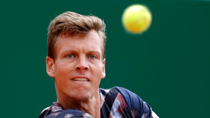Tomas Berdych of Czech Republic plays a return to Milos Raonic of Canada during the quarterfinal match at the Monte Carlo Tennis Masters tournament in Monaco, Friday April 17, 2015. Tomas Berdych advanced to the semifinals of the Monte Carlo Masters after Milos Raonic retired with a foot injury. (AP Photo/Lionel Cironneau)