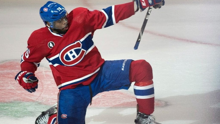 Montreal Canadiens' P.K. Subban celebrates his goal past Ottawa Senators goalie Andrew Hammond during the second period in Game 2 of an NHL hockey first-round playoff series, Friday, April 17, 2015 in Montreal. (Paul Chiasson/The Canadian Press via AP)  MANDATORY CREDIT