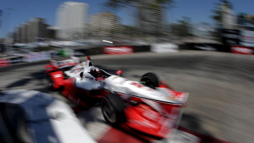 Juan Pablo Montoya drives during a practice for the IndyCar Toyota Grand Prix of Long Beach auto race on Friday, April 17, 2015 in Long Beach, Calif. (AP Photo/Chris Carlson)