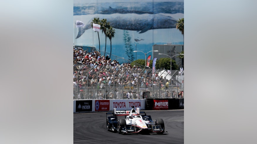 Will Power goes into a turn during a practice run for the IndyCar race at the Toyota Grand Prix of Long Beach on Friday, April 17, 2015 in Long Beach, Calif. (AP Photo/Chris Carlson)