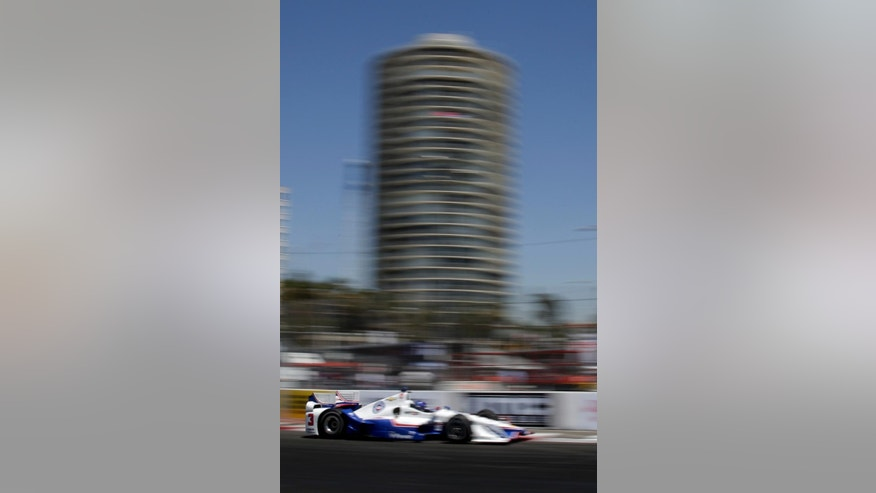 Helio Castroneves drives drives during practice for the IndyCar Toyota Grand Prix of Long Beach auto race, Friday, April 17, 2015 in Long Beach, Calif. (AP Photo/Chris Carlson)