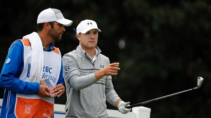 Jordan Spieth, right, talks with his caddie, Michael Greller, on the 17th tee during the second round of the RBC Heritage golf tournament in Hilton Head Island, S.C., Friday, April 17, 2015. (AP Photo/Stephen B. Morton)