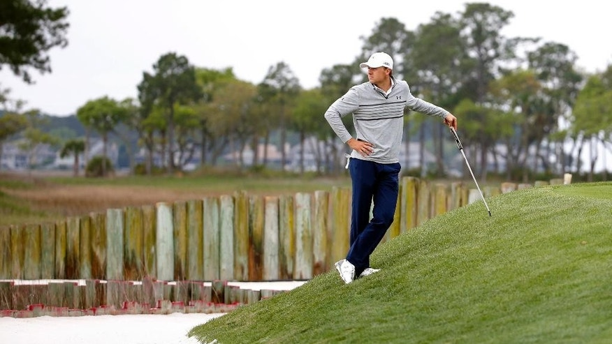 Jordan Spieth waits for his turn to putt on the 17th green during the second round of the RBC Heritage golf tournament in Hilton Head Island, S.C., Friday, April 17, 2015. (AP Photo/Stephen B. Morton)