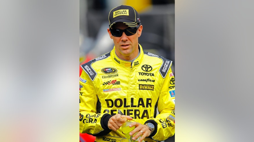 Matt Kenseth walks through the pit area during practice for a NASCAR Sprint Cup Series auto race at Bristol Motor Speedway on Friday, April 17, 2015, in Bristol, Tenn. Kenseth will start on the pole Sunday. (AP Photo/Wade Payne)