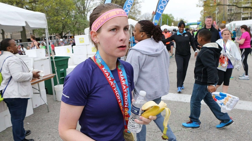 April 12, 2015: Kendall Schler, 26, is seen moments after crossing the finish line of the Go! Marathon.