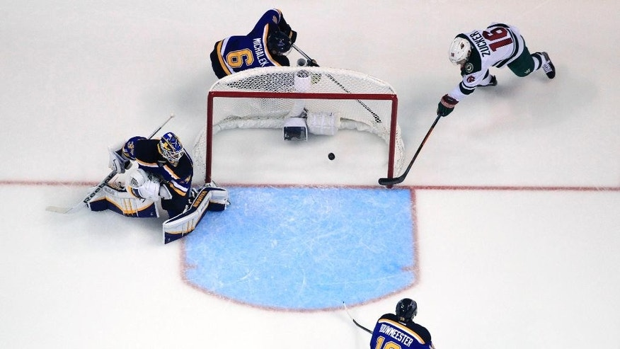 Minnesota Wild's Jason Zucker, top right, scores as St. Louis Blues' Zbynek Michalek, of the Czech Republic, goalie Jake Allen, left, and Jay Bouwmeester, bottom, watch during the first period in Game 1 of an NHL hockey first-round playoff series, Thursday, April 16, 2015, in St. Louis. (AP Photo/Jeff Roberson)