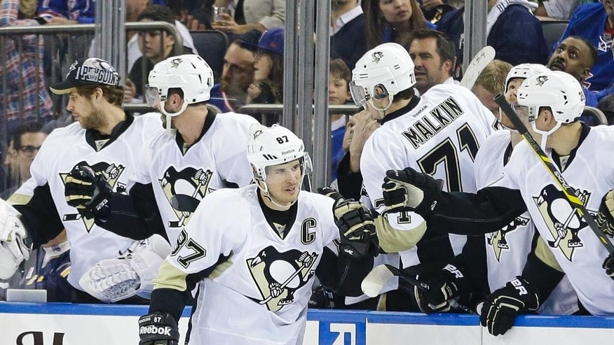 Pittsburgh Penguins' Sidney Crosby (87) celebrates with teammates after scoring a goal during the second period of Game 2 against the New York Rangers in the first round of the NHL hockey Stanley Cup playoffs Saturday, April 18, 2015, in New York. (AP Photo/Frank Franklin II)