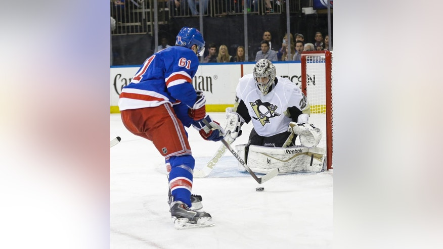 Pittsburgh Penguins goalie Marc-Andre Fleury (29) watches as New York Rangers' Rick Nash (61) attempts to score during the second period of Game 2 in the first round of the NHL hockey Stanley Cup playoffs Saturday, April 18, 2015, in New York. (AP Photo/Frank Franklin II)