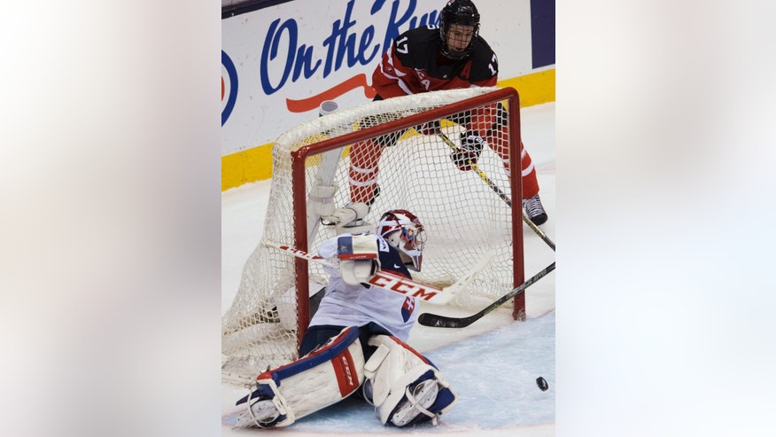 FILE - In this Jan. 4, 2015, file photo, Canada forward Connor McDavid (17) tries for a wraparound past Slovakia goalie Denis Godla during first-period semifinal hockey action at the world junior championships in Toronto. The Edmonton Oilers have won the NHL draft lottery and the right to select McDavid first overall. (Nathan Denette/The Canadian Press via AP, File) MANDATORY CREDIT