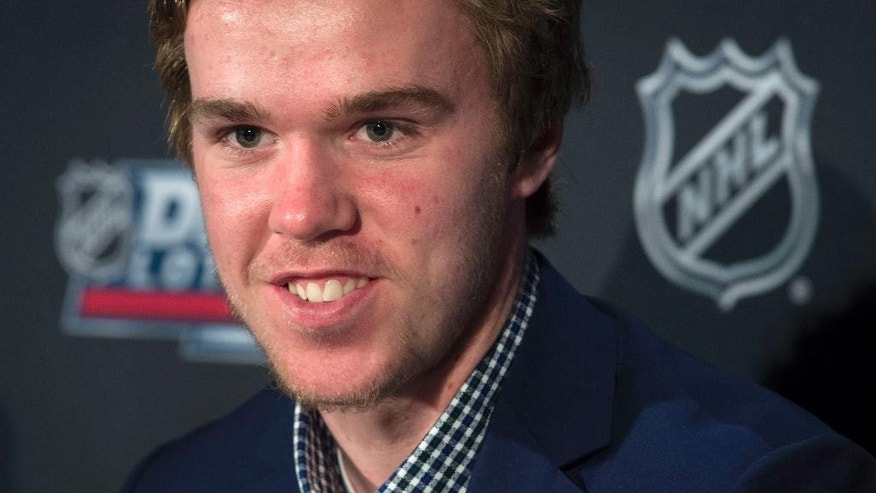 Connor McDavid speaks to reporters in Toronto on Saturday, April 18, 2015. The Edmonton Oilers have won the NHL draft lottery and the right to select Connor McDavid with the first pick in the draft. (Darren Calabrese/The Canadian Press via AP)