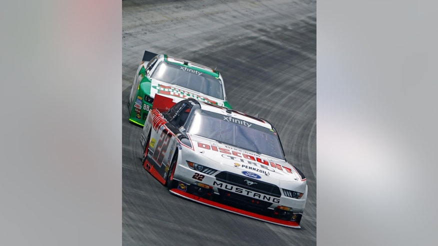 Driver Joey Logano (22) leads Kevin Harvick (88) during the NASCAR Xfinity Series auto race at Bristol Motor Speedway on Saturday, April 18, 2015, in Bristol, Tenn. (AP Photo/Wade Payne)