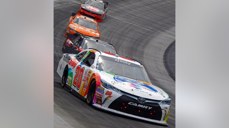 Driver Erik Jones (20) leads the field during the NASCAR Xfinity Series auto race at Bristol Motor Speedway on Saturday, April 18, 2015, in Bristol, Tenn. (AP Photo/Wade Payne)