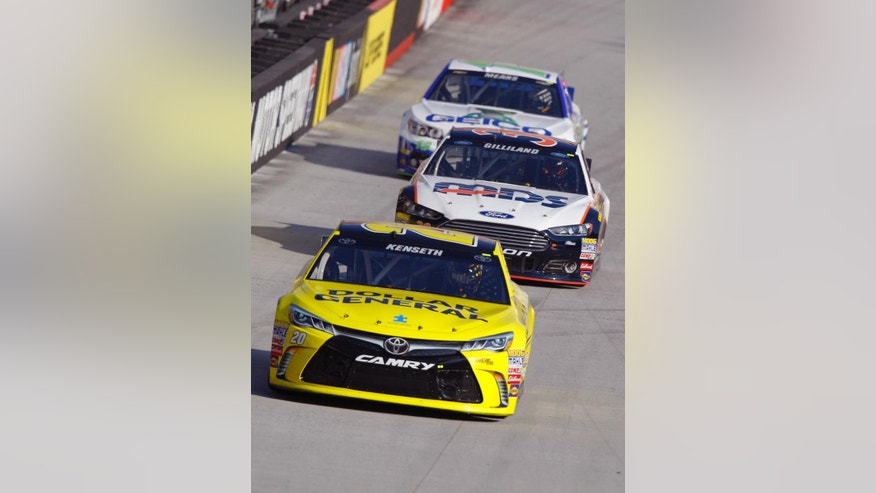 Driver Matt Kenneth leads David Gilliland and Casey Mears during practice for a NASCAR Sprint Cup Series auto race at Bristol Motor Speedway on Saturday, April 18, 2015, in Bristol, Tenn. (AP Photo/Wade Payne)