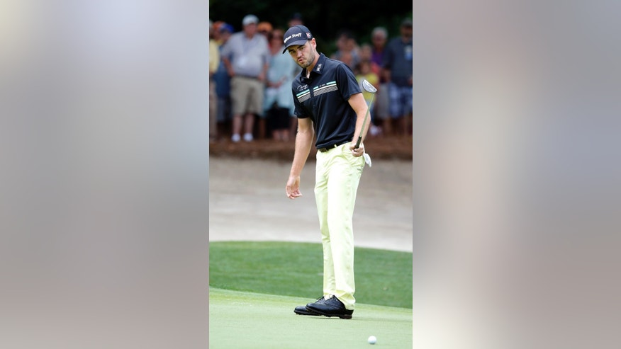 Troy Merritt reacts after missing a putt on the second green during the third round of the RBC Heritage golf tournament in Hilton Head Island, S.C., Saturday, April 18, 2015. (AP Photo/Stephen B. Morton)